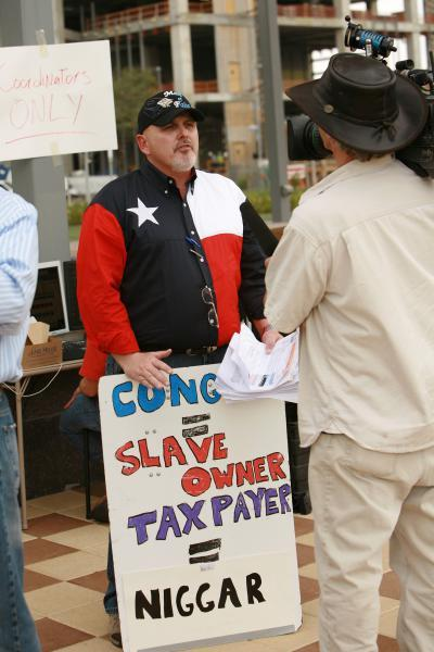 "Vitriolic Past: The self-proclaimed founder of TeaParty.org carried a controversial sign at the February 27, 2009 Tea Party in Houston. The word at the top of the sign is ""Congress."" (Image courtesy of the Washington Independent)"